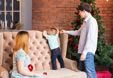 Christmas, x-mas, family, people, happiness concept - happy parents playing with cute baby boy Stock Photography
