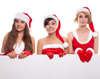 Christmas, x-mas, people, advertisement and sale concept three Stock Image