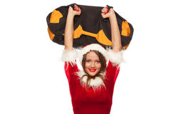 Christmas, x-mas, winter, happiness concept - Bodybuilding. Strong fit woman exercising with SANDBAG in santa helper hat Royalty Free Stock Photo