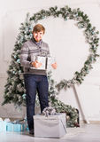 Christmas, x-mas, winter, happiness concept - smiling man with gift box Stock Images