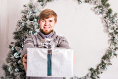 Christmas, x-mas, winter, happiness concept - smiling man with gift box Royalty Free Stock Photo