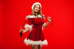 Christmas, x-mas, winter, happiness concept - Sport, activity. Cute woman with skipping rope  in santa helper hat , over Stock Photos