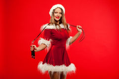 Christmas, x-mas, winter, happiness concept - Sport, activity. Cute woman with skipping rope in santa helper hat , over Royalty Free Stock Photography
