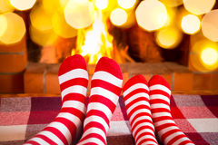 Christmas Xmas Family Holiday Winter. Family in Christmas socks near fireplace. Mother; father and baby having fun together. People relaxing at home. Winter Royalty Free Stock Image