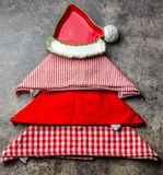 Christmas xmas food background with copy space. Christmas tree made from kitchen napkins and red plate. Gray stone. Ackground. Holiday menu or cooking concept Stock Image