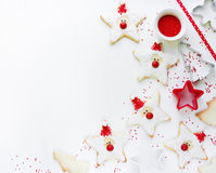 Christmas Xmas New Year baking concept with cute holiday santa c. Ookies and red sugar decorations on white background copyspace stock photography
