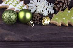 Christmas Xmas New Year Decoration with snowflakes cookies christmas balls bell fir cones on dark wooden background Royalty Free Stock Photos