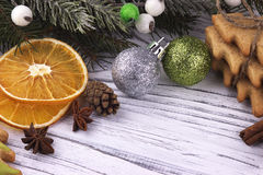 Christmas Xmas New Year holiday Decoration with dried oranges cookies star anise cinnamon cones natural fir branches green and. Silver balls on white wooden stock photo