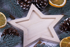 Christmas Xmas New Year Holiday greeting card with empty star fir branches cones star anice cinnamone dried oranges on white woode Stock Images