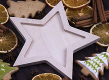 Christmas Xmas New Year Holiday greeting card with empty wooden star cones star anice cinnamone dried oranges Christmas tree cooki Stock Photos