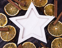 Christmas Xmas New Year Holiday greeting card with empty wooden star cones star anice cinnamone dried oranges on dark wooden backg Stock Image