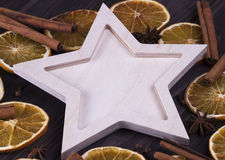 Christmas Xmas New Year Holiday greeting card with empty wooden star cones star anice cinnamone dried oranges on white wooden back Stock Images