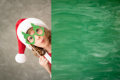 Christmas Xmas Winter Holiday Concept. Child holding banner. Kid hiding behind card blank. Christmas Xmas winter holiday concept Royalty Free Stock Photo