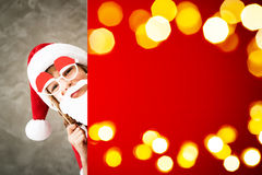 Christmas Xmas Winter Holiday Concept. Child holding banner. Kid hiding behind card blank. Christmas Xmas winter holiday concept Royalty Free Stock Photos