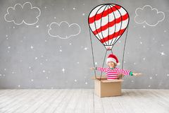 Christmas Xmas Winter Holiday Concept. Happy child in Christmas time. Funny kid playing at home. Xmas winter holiday concept stock images