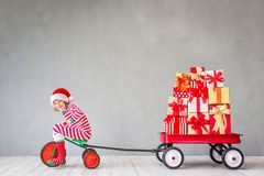 Christmas Xmas Winter Holiday Concept. Happy child with Christmas gift. Kid having fun at home. Xmas holiday concept royalty free stock image