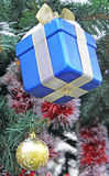 Christmas yellow ball and blue gift Royalty Free Stock Photos
