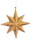 Christmas yellow shiny star isolated over white background Stock Photo