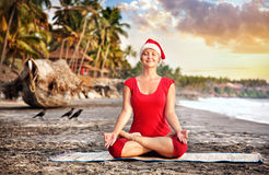 Christmas yoga on the beach Royalty Free Stock Images