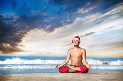Christmas yoga on the beach Royalty Free Stock Photo