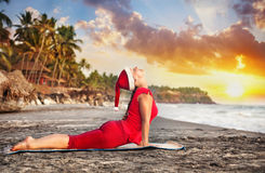 Christmas yoga on the beach Royalty Free Stock Photo