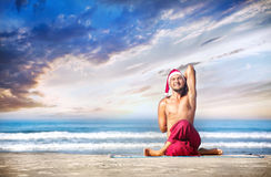 Christmas yoga on the beach Royalty Free Stock Photography