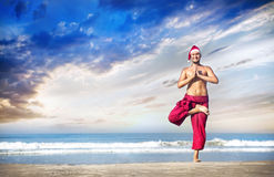 Christmas yoga on the beach Stock Photo