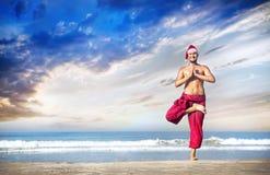 Christmas yoga on the beach Stock Photo