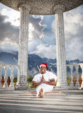 Christmas yoga in mountain Stock Images
