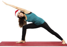Christmas yoga woman doing extended side angle pose Stock Photography