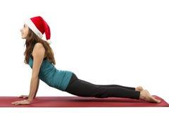 Christmas yoga woman doing upward facing dog Royalty Free Stock Photos