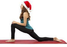Christmas yoga woman in low lunge position Stock Images