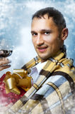 Christmas. Young adult handsome man Stock Photos
