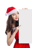 Christmas young asian woman showing blank billboard banner sign Stock Images