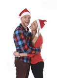 Christmas young beautiful couple in Santa hats in love smiling happy together hugging each other sweet Stock Photography