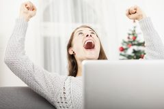 Christmas young girl raise arms into the air and screams Royalty Free Stock Image