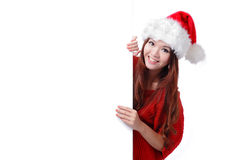 Christmas young girl showing blank billboard Stock Photo