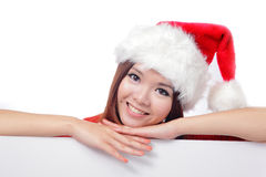 Christmas young girl showing blank billboard Royalty Free Stock Photo