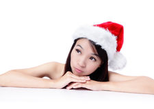 Christmas young girl showing blank billboard Royalty Free Stock Photos