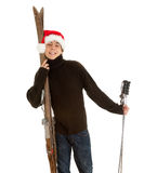 Christmas young  man with old wooden ski Stock Photos