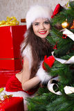 Christmas with young woman wearing santa claus. Clothes at home Stock Photo