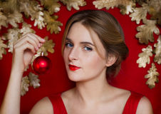Christmas youth beauty on a red background with Golden luxury Stock Images