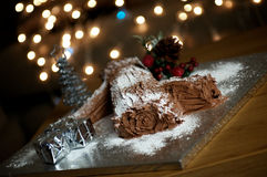 Christmas Yule Log. Beautiful Christmas Yule Log with twinkling lights in the background Royalty Free Stock Images