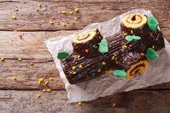 Christmas Yule Log, Buche de Noel, chocolate cake closeup. horiz Stock Photo