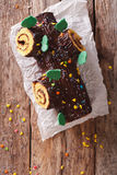 Christmas Yule Log, Buche de Noel, chocolate cake closeup. verti Royalty Free Stock Photography