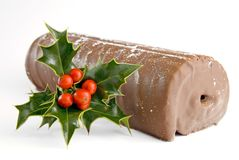Christmas Yule log with holly Royalty Free Stock Images