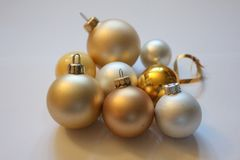 Christmasballs. Several christmasballs in the colours gold and white on a isolated background Royalty Free Stock Photography