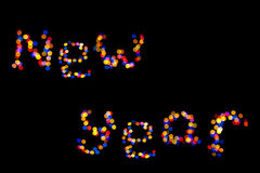 Christmaslight como el Año Nuevo de la inscripción Fotografía de archivo