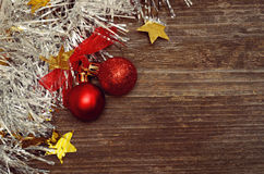 Christmass balls and tinsel on wood Stock Images