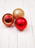 Christmass balls on a white background. Christmass balls on white wooden background royalty free stock photo